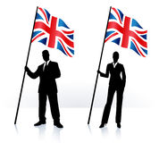 Business silhouettes with waving flag of United Kingdom Stock Photos