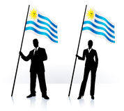 Business silhouettes with waving flag of uruguay Royalty Free Stock Photos