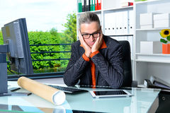 Business sitting overworked in the office Royalty Free Stock Images