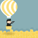 Business situation. Businessman flying in a balloon. Stock Photography