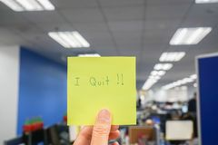 Business situation concept of resignation in office - close up people with I quit message in workplace royalty free stock photography