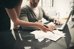 Business situation, signs contracts. Account manager working modern office with new business project. Using laptop Stock Image