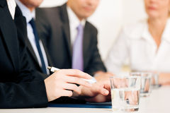 Business situation - team in meeting Stock Photo