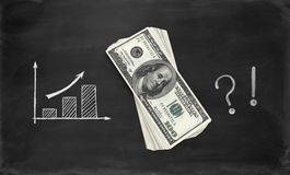 Business sketches and dollars on chalkboard Royalty Free Stock Photo