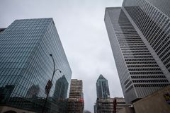 Business skyscrapers in the dowtown of Montreal, Quebec, on a rainy day, taken in the center business district. MONTREAL, CANADA - NOVEMBER 3, 2018:Picture of royalty free stock photos