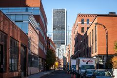 Business skyscrapers in the dowtown of Montreal, seen from a nearby street of the main city of Quebec. MONTREAL, CANADA - NOVEMBER 4, 2018: Picture of stock photography
