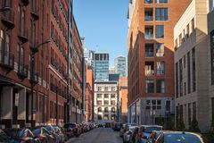 Business skyscrapers in the dowtown of Montreal, seen from a nearby street of the main city of Quebec. Picture of skyscrapers during a cold and sunny afternoon royalty free stock photography