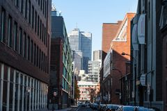 Business skyscrapers in the dowtown of Montreal, seen from a nearby street of the main city of Quebec, symbol of Canadian economy. Picture of skyscrapers during royalty free stock images