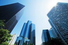 Business skyscrapers. La Defense, Paris, France. Business skyscrapers, sunny blue sky. La Defense financial district in Paris, France Stock Photos