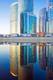 Business skyscrapers and reflections in the river Stock Photos
