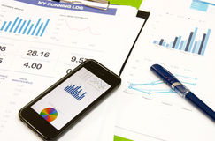 Business smart phone. And pen on desk Royalty Free Stock Images