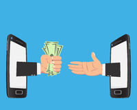 Business on smartphone. Hand of businessman with money show up from smartphone screen  on blue background Royalty Free Stock Image