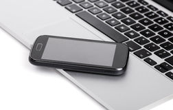 Business smartphone on the laptop Stock Images