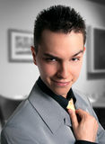 Business smile. Handsome young business man smileing in the camera Stock Photography