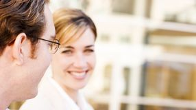 Business smile. Business man and woman talking with smiles Stock Photography