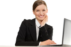 Business smiling worker with laptop. Sitting. Hands close to the face Royalty Free Stock Photos
