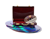 Business Software. A stack of purple dvds and a burgandy leather briefcase Stock Images