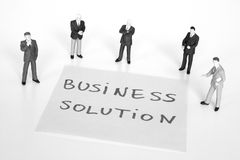 Business solution. Trying to find a suitable business solution together Royalty Free Stock Images