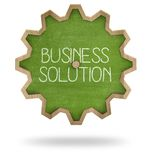 Business solution on gear shape blackboard Royalty Free Stock Images