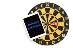 Business solution on tablet screen with dartboard Royalty Free Stock Photography