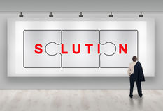 Business solutions advertisement. Clever business solutions advertisement banner with businessman looking Stock Photo