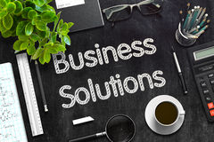 Business Solutions on Black Chalkboard. 3D Rendering. Royalty Free Stock Photo