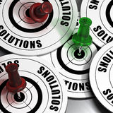 Business solutions concept. Solutions targets green and red pushpins Stock Photos