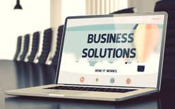Business Solutions Concept on Laptop Screen. 3d. Closeup Business Solutions Concept on Landing Page of Laptop Screen in Modern Meeting Hall. Toned Image. Blurred Royalty Free Stock Image