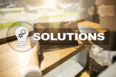 Business solutions concept on the virtual screen. Business solutions concept on the virtual screen Stock Image