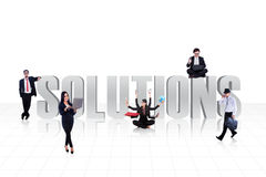 Business solutions on white. The word SOLUTIONS surround with business people isolated on white Stock Images