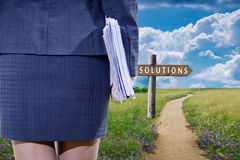 Business solutions. Business woman with the roads and signage solutions to problems Stock Photography
