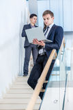 Business solutions.Young and successful businessman standing on Stock Image