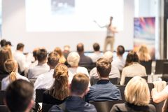 Business speaker giving a talk at business conference event. Royalty Free Stock Photo