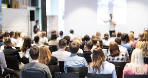 Business speaker giving a talk at business conference event. Stock Image