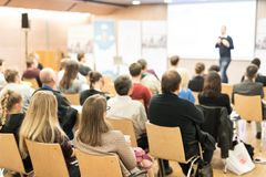 Business speaker giving a talk at business conference event. stock photo