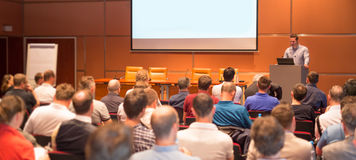 Business speaker giving a talk in conference hall. Royalty Free Stock Images