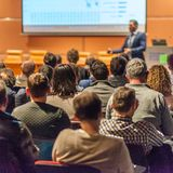 Business speaker giving a talk in conference hall. stock image
