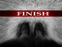 Business Speedy Finish. Speedy Finish line with businessman wearing dress shoes as metaphor for finishing work as a winner Royalty Free Stock Photo