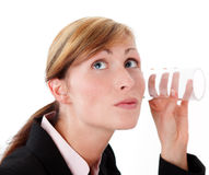Business spy. Woman listening on wall with glass Stock Photos