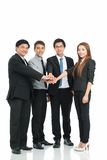 We are the team!. Business staff holding pile hands isolated Royalty Free Stock Image