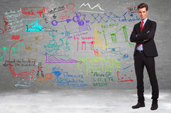 Business standing in front of a wall full of calculations. Conident business standing in front of a wall full of calculations and diagrams stock images