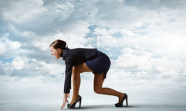Business start. Side view of businesswoman standing in start position Royalty Free Stock Photos