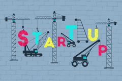 Business startup concept. Construction site working on lifting the startup wording Royalty Free Stock Images