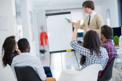 Business, startup and people concept - happy creative team talking in office Stock Images