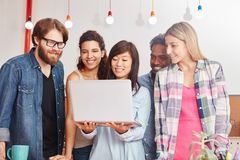 Business startup team with laptop. Makes marketing in social media Stock Photo