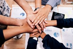 Business startup Teamwork joining hands team spirit Collaboratio Stock Photo