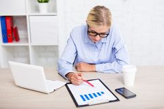 Business and statistics concept - business woman with charts and Royalty Free Stock Photos