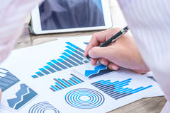 Business statistics success concept : businessman analytics char Stock Photography