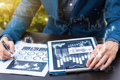 Business statistics success concept : businessman analytics fina. Ncial accounting market chart and graph line  ,selective focus Royalty Free Stock Photos