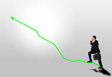 Business step up stair green arrow graph progress. Businessman holding mobile phone and walking to his target Stock Photos